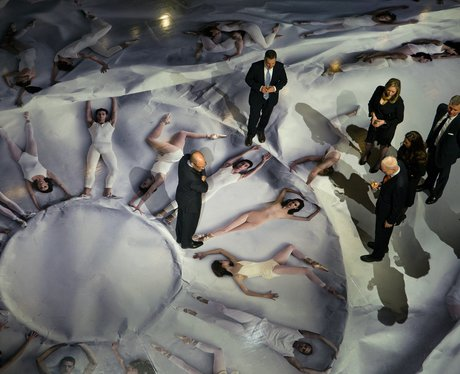 picture of balled dancers lying down