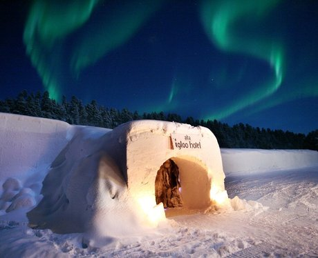 the northern lights about an igloo