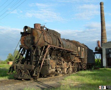 derelict train in field