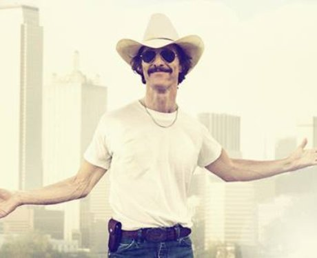 Matthew McConaughey in a white shirt and cowboy hat