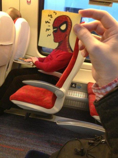 Spiderman postit on man on train.