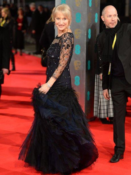 Helen Mirren swirling her black dress on the BAFTA red carpet