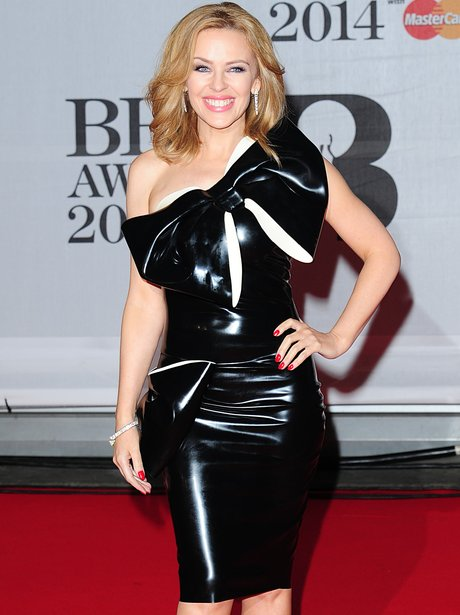 Kylie Minogue in a latex dress with on the red carpet at the Brit Awards 2014
