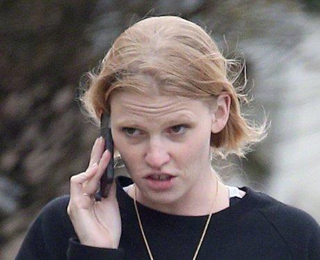 Lara Stone without make up on the phone