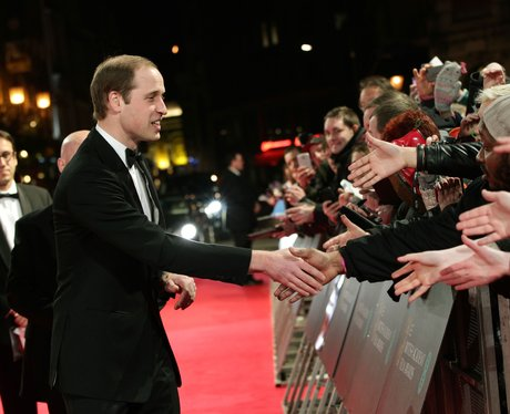Prince William greeting people on the red carpet