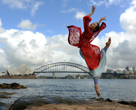 A woman dancing in Sydney harbour