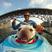Image 7: A man kayaking with his dog