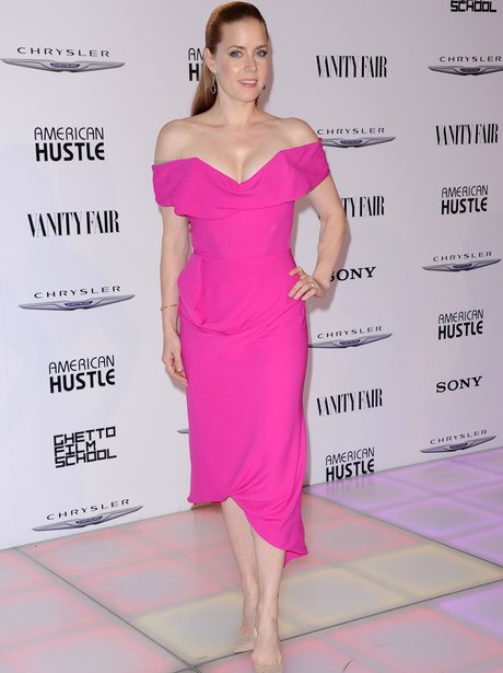 Amy Adams in a neon pink dress and nude heels