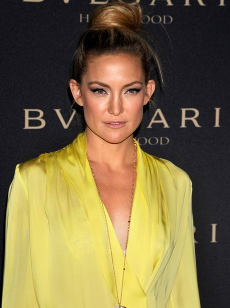 Kate Hudson in a long-sleeved yellow top