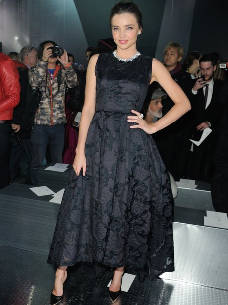 Miranda Kerr in a black dress with diamond collar