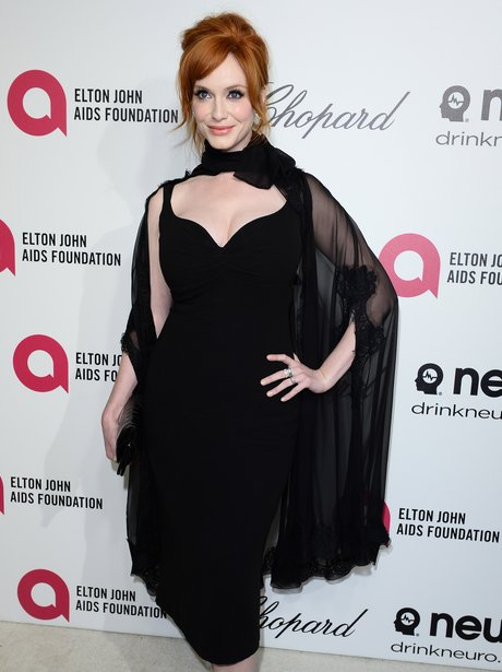 Christina Hendricks in a black dress and cape at the Oscars 2014