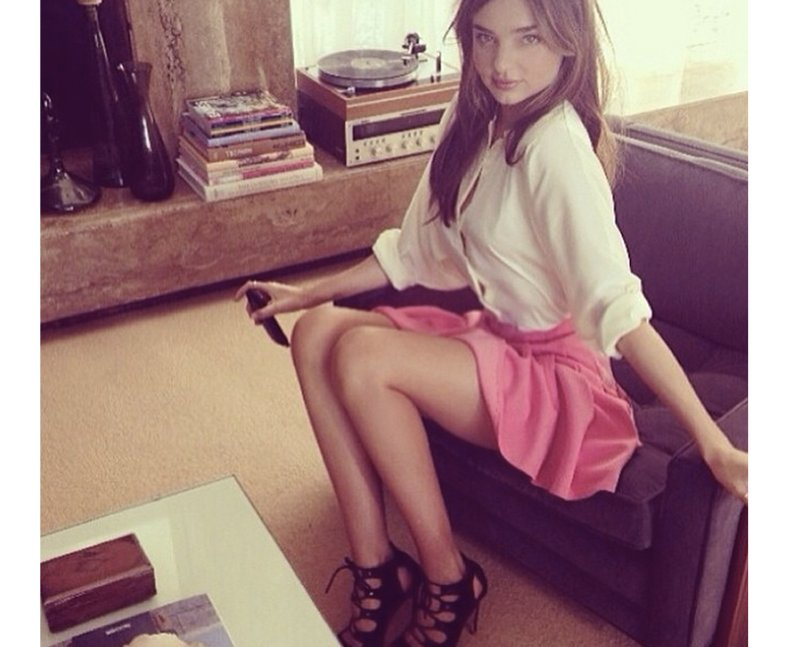 Miranda Kerr posing on a sofa