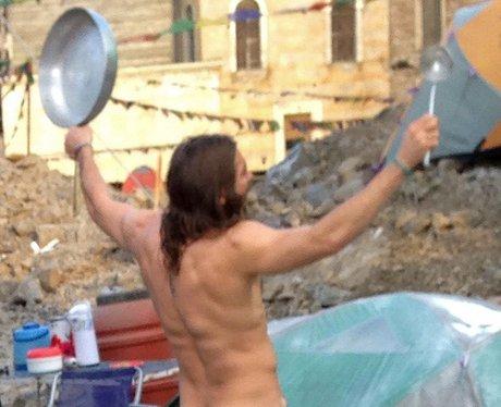 Jake Gyllenhaal naked holding a saucepan