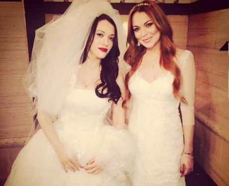Kat Dennings and Lindsay Lohan in wedding dresses