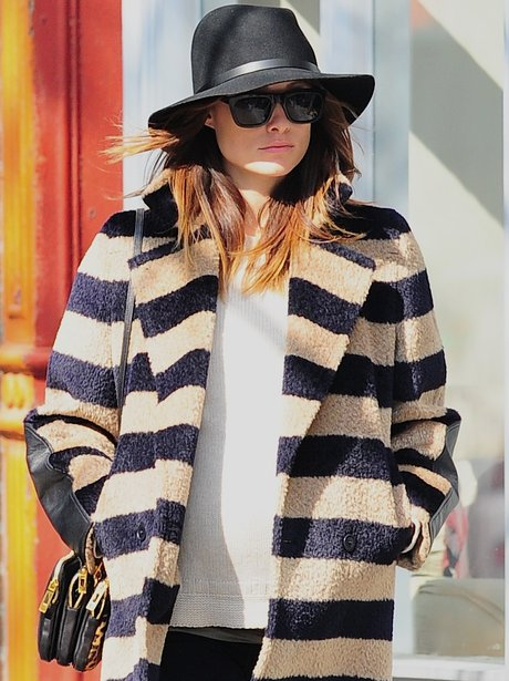 Olivia Wilde in a hat and stripy cardigan