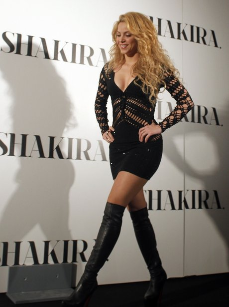 Shakira in a laced black dress