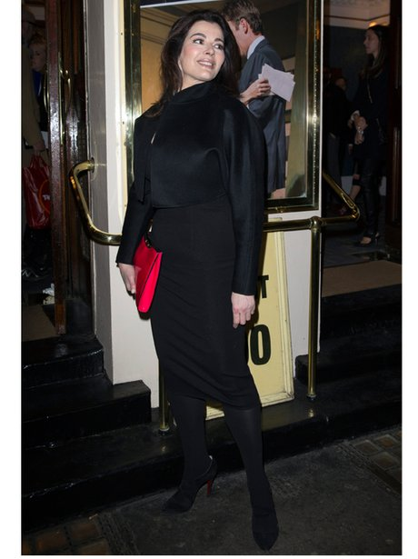 Nigella Lawson with a neon pink clutch bag