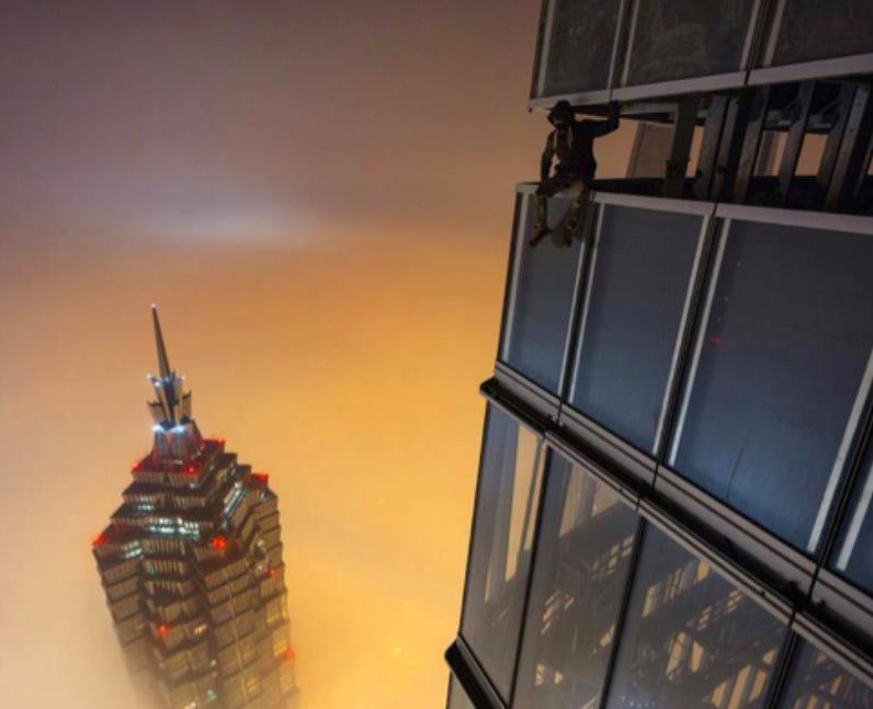 A man sitting above the Shanhai skyline