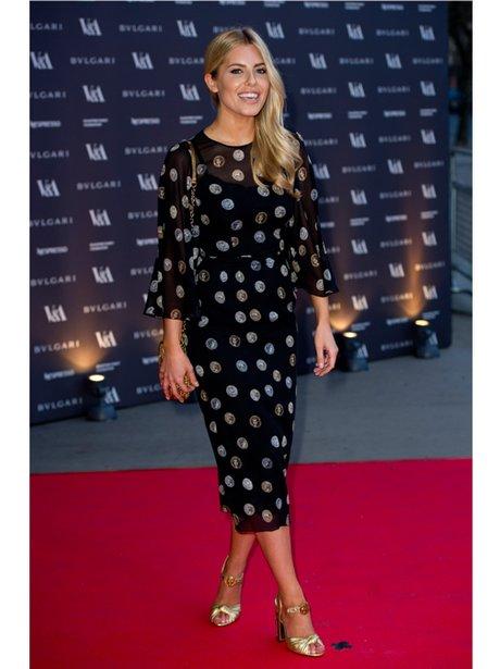 Mollie King in a black spotty dress
