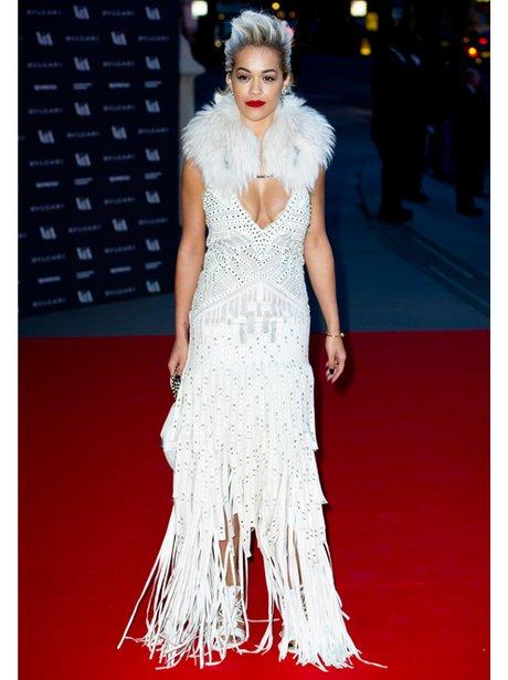 Rita Ora in a low cut white dress