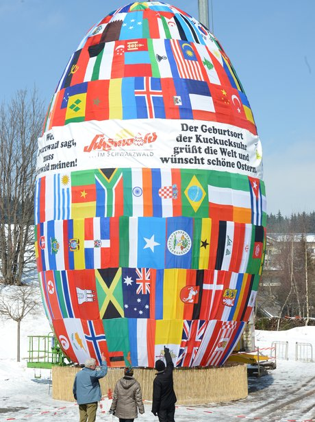 A giant egg with the flags or the world on