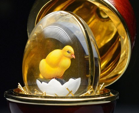 A glass egg with a chick inside