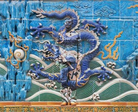 liu bolin camouflaged in a mural