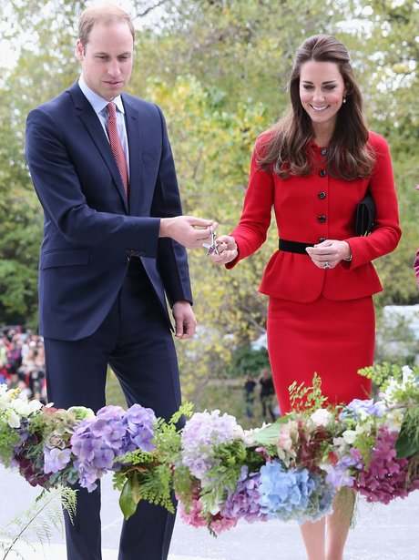The Duke and Duchess Of Cambridge cutting a flower rope