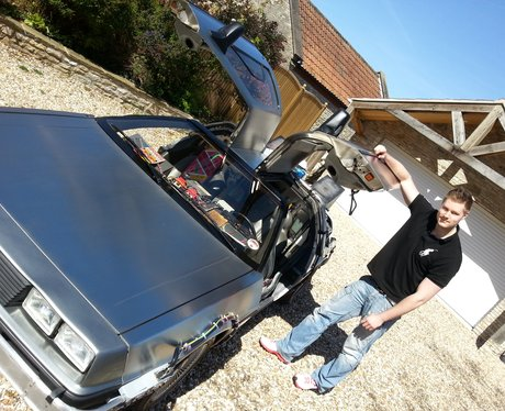 Ollie Wilkie by his replica DeLorean