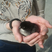 Image 9: A chick sitting in a person's hand