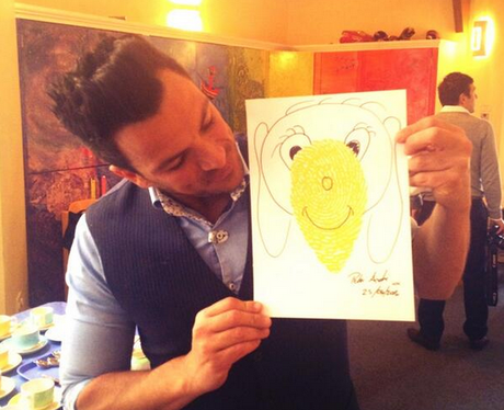 Peter Andre with a child's picture