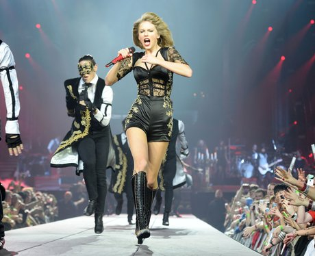 Taylor Swift performing on her RED Tour