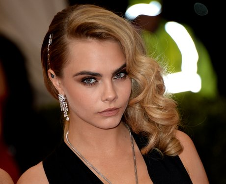 Cara Delevinge in a black top