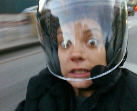 Lily Allen looks scared on a motorbike