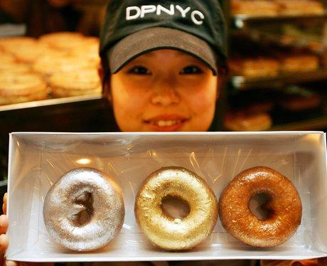 three gilded doughnuts