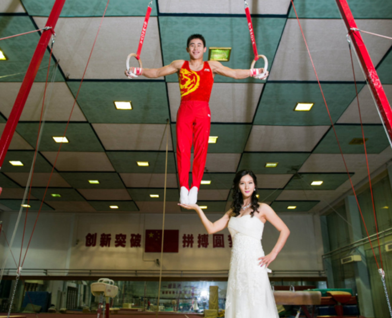 A bride balancing her gymnast husband