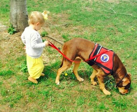 Vivian Lake Brady walking a dog