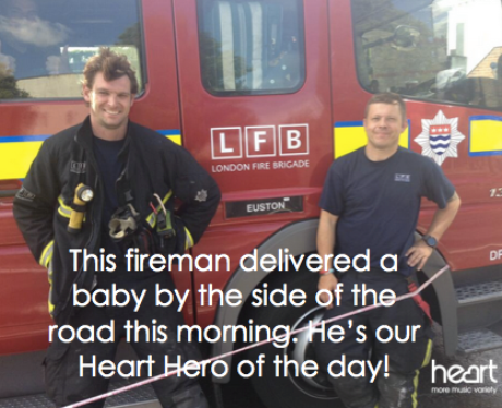 Two firemen by their truck