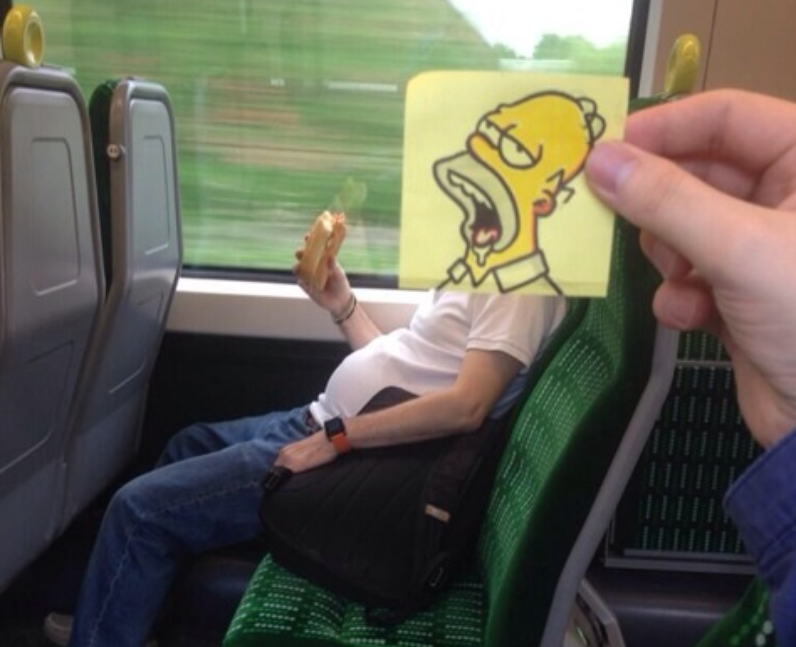 A person eating on a train