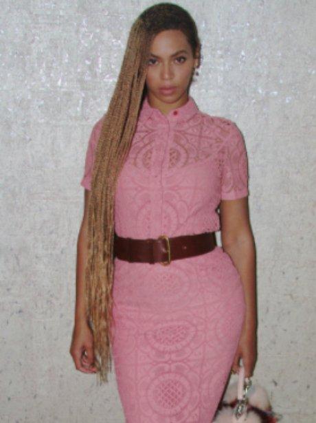 Beyonce wears a lace pink dress