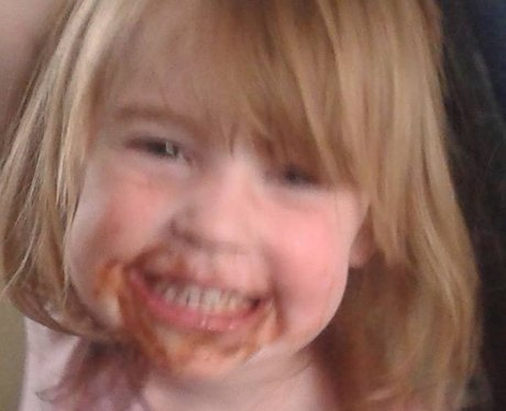 A little girl with chocolate around her mouth