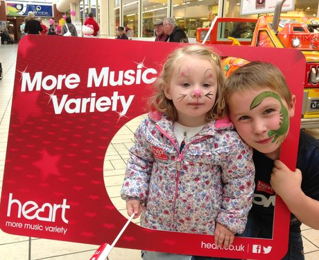 two children with face painting in the heart frame