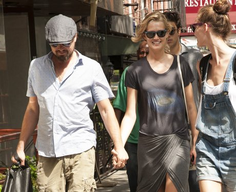 Leonardo Dicaprio and Toni Garrn hold hands