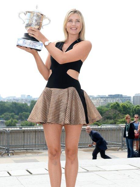 Maria Sharapova holding a trophy