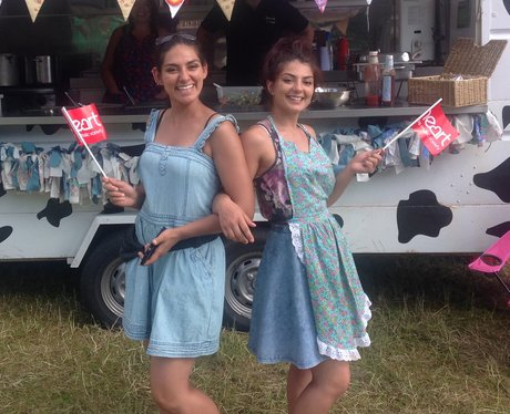 Two ladies pose with Heart flags.