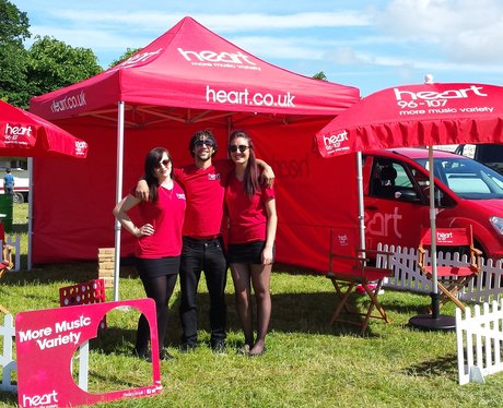 Heart Angels pose in the set-up area in the sun.