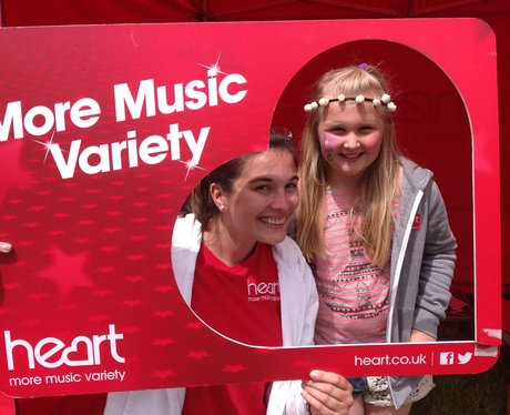 A young girl poses for a photo with a Heart Angel.