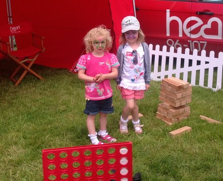 Two little girls playing with jenga and connect 4.