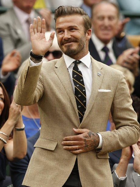 David Beckham waves to his fans at Wimbledon