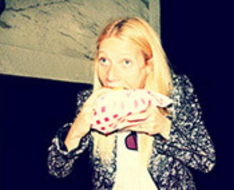 Gwyneth Paltrow eating a burger